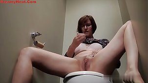 Adult unilluminated masturbating during toilet invest in