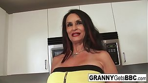 Busty brunette granny takes an obstacle black cock in her wet pussy