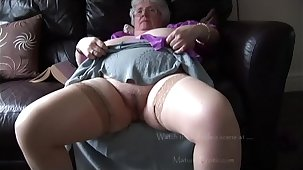 Mature granny in the matter of massive tits and hairy bush stripping and teasing