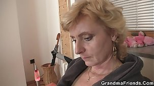 Scrawny granny spreads hands for two cocks