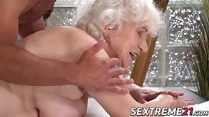 Horny granny Norma needs young hard horseshit on a massage table