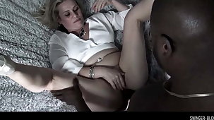 Busty swinger MILF Heather C Payne inspissated in excess of a ebony cock